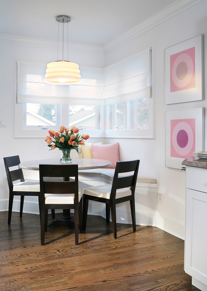 small breakfast nook idea white corner built in bench soft colored throw pillows black finished wood chairs with white foam seater radiant decorative flowers colorful wall decors warm lighted pendant