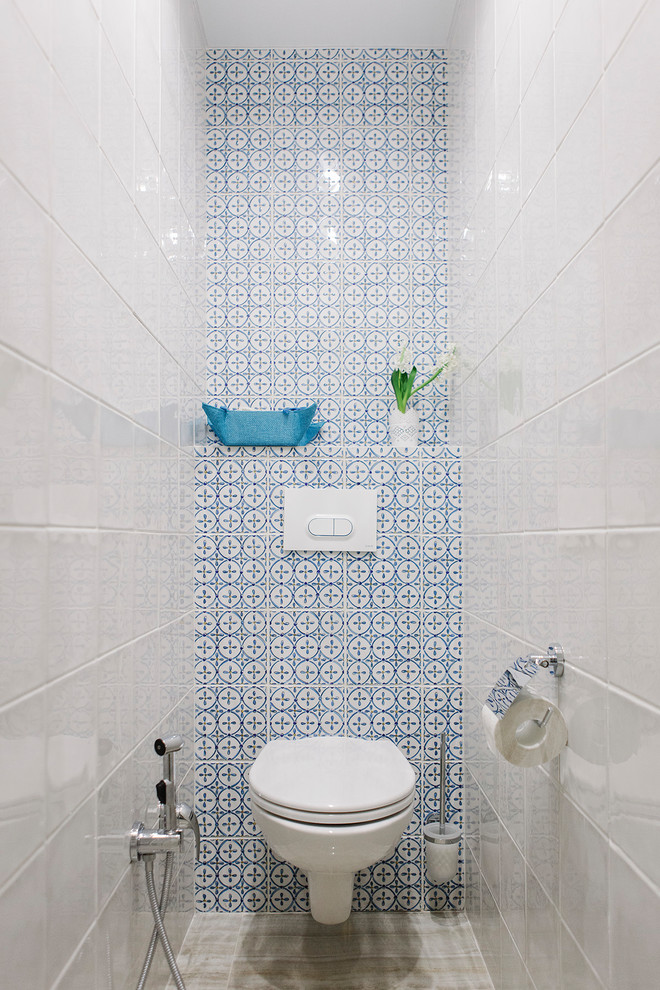 small contemporary bathroom blue mosaic tiles wall background white tiles walls wall mounted toilet in white
