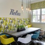 Small Contemporary Breakfast Nook Colorful Wallpaper Colorful Mid Century Modern Plastic Chairs Rustic Wood Dining Table Built In Bench Bulb Pendants