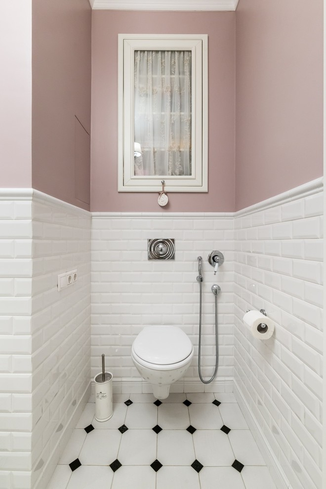 small traditional bathroom white brick under walls periwinkle colored top walls wall mounted toilet in white white tiles floors with black diamond cut accents