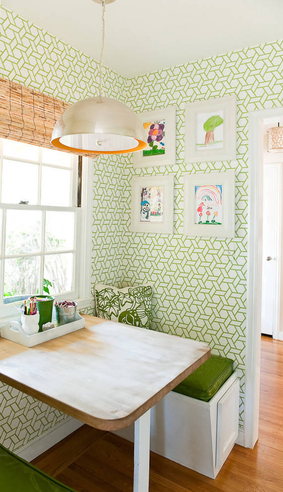 smaller contemporary breakfast nook built in benches with green foam seater butcher block table green wallpaper with geometric patterns larger contemporary pendant medium toned wood floors