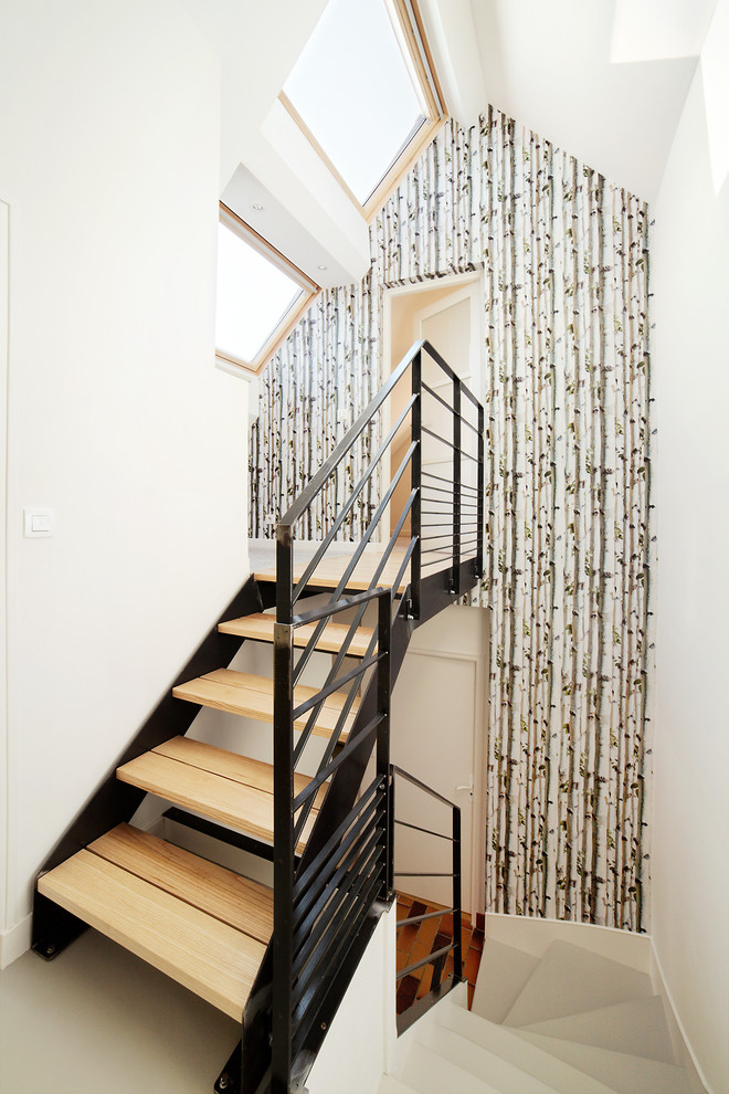 smaller scandinavian staircase with black coated metal rails wood steps full length drapery skylights