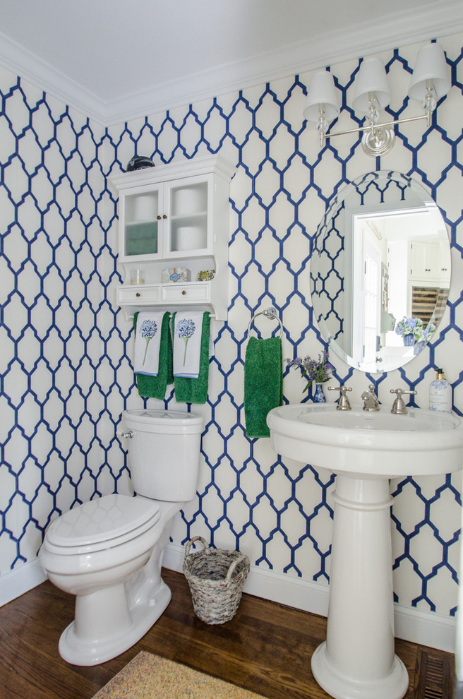 traditional bathroom in small size classic navy wallpaper white pedestal sink white toilet hardwood floors oval shaped mirror