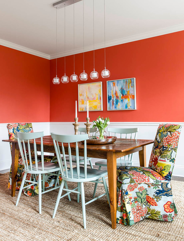 transitional dining room red bold painting walls a couple of abstract wall arts modern pendants light turquoise dining chairs chairs with multicolored fabrics slipcovers