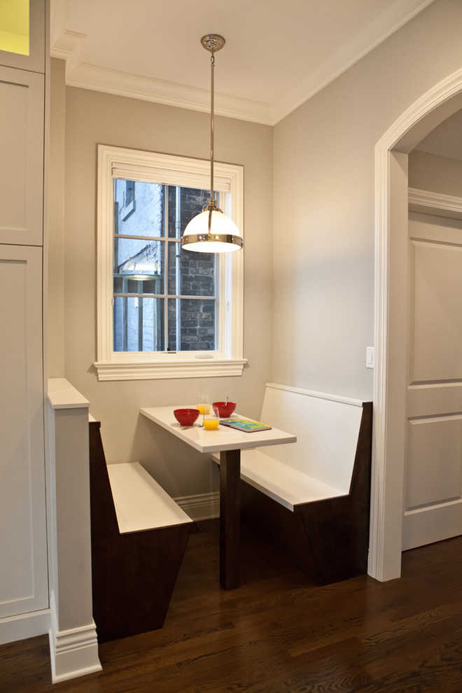 very small breakfast nook built in banquettes built in table dark wood floors center glass window contemporary pendant light grey walls white window trims