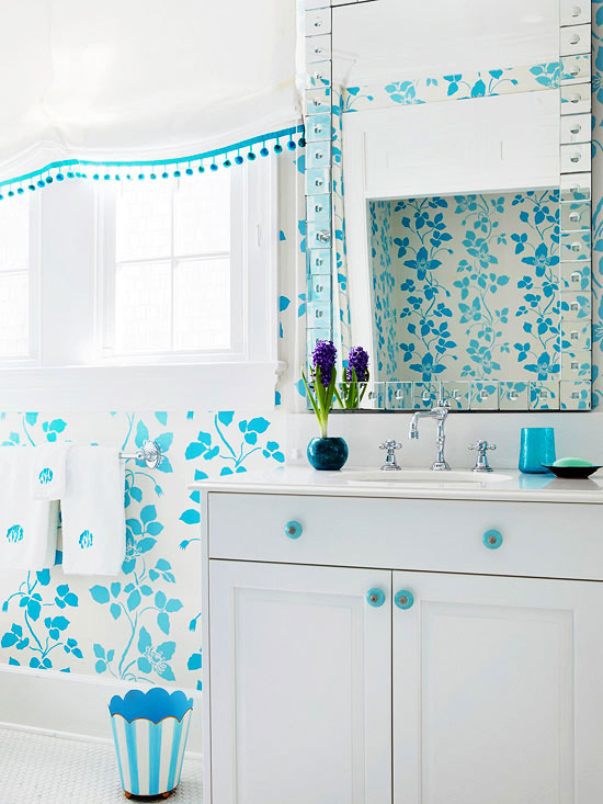 white bathroom vanity with radiant blue buttons radiant blue wallpaper stripped trash can chrome towel hang