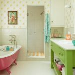 beach style bathroom green bathroom vanity with white undermount sink bathtub with pink frame vintage tiled walls with yellow patterns vintage tiled floors with yellow diamond cut patterns