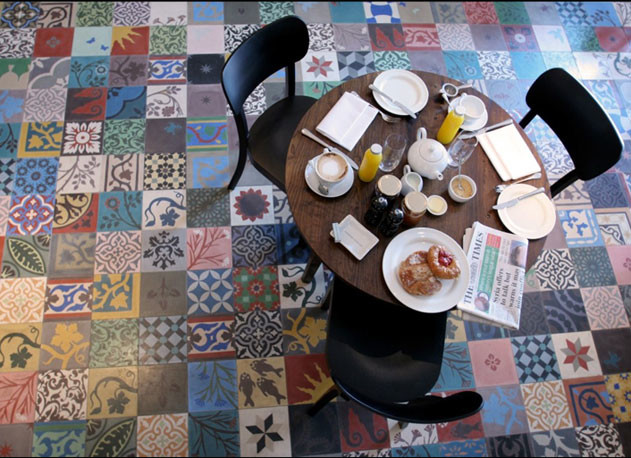 breakfast nook black dining chairs round top wood table multicolored vintage tiles
