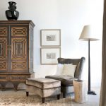classic armoire with handcrafting details shabby armchair shabby ottoman tree trunk side table floor lamp