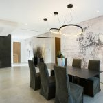 contemporary dining room black dining chair slipcovers black finishing dining table whitewashed brick wall with creative painting contemporary pendants