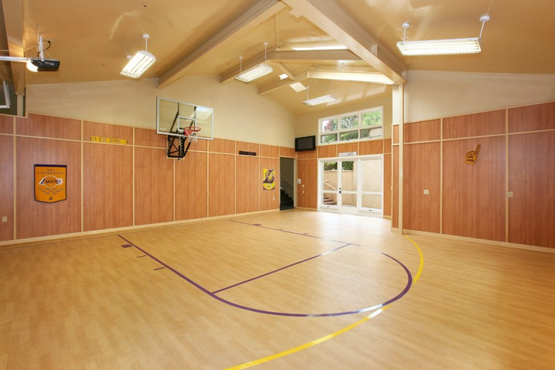 contemporary indoor basketball court idea hardwood laminate floors darker wood laminate walls light cream painted ceilings
