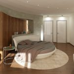 Contemporary Kids' Round Platform Bed Frame With Curvy Queen Headboard Grey Blanket Grey Pillows Round Cream Area Rug Medium Toned Wood Floors Modern Bedside Table With Round Top
