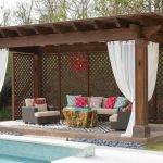 contemporary pergola with poly carbonate ebclosure cedar lattice panels white outdoor curtains flaming red gazebo lighting fixtures outdoor furniture set