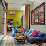 eclectic & formal living room colorful low couch low wooden coffee table vintage area rug colorful throw pillows