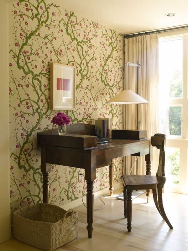 eclectic home office design dark wood working desk dark wood working chair vines wallpaper with flowers light wood floors warm toned curtains