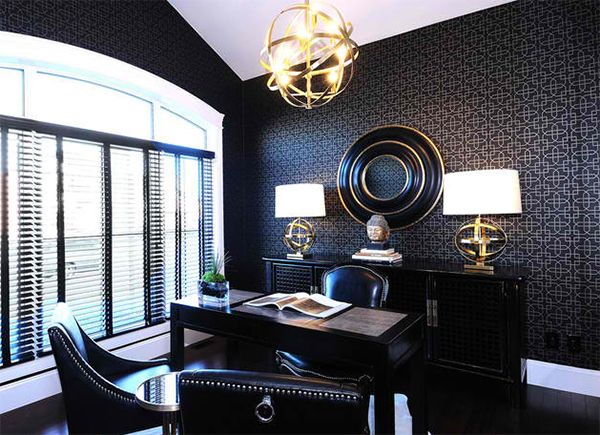 elegant & classy home office with black wallpaper and gold & silver accents black leather working chairs glowing black working desk