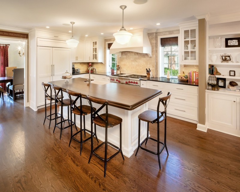 farmhouse kitchen idea medium toned wood kitchen island with undermount sink medium toned wood bar stools with back medium toned wood floors white kitchen cabinets