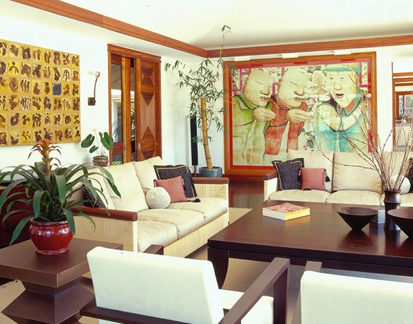 formal living room Asian inspired print on wall light beige sofa dark wood coffee table dark wood side table white chairs decorative China bamboos