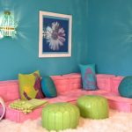 fun pink floor couch blue and yellow throw pillows green ottomans fluffy & cloud like pink rug blue painted walls