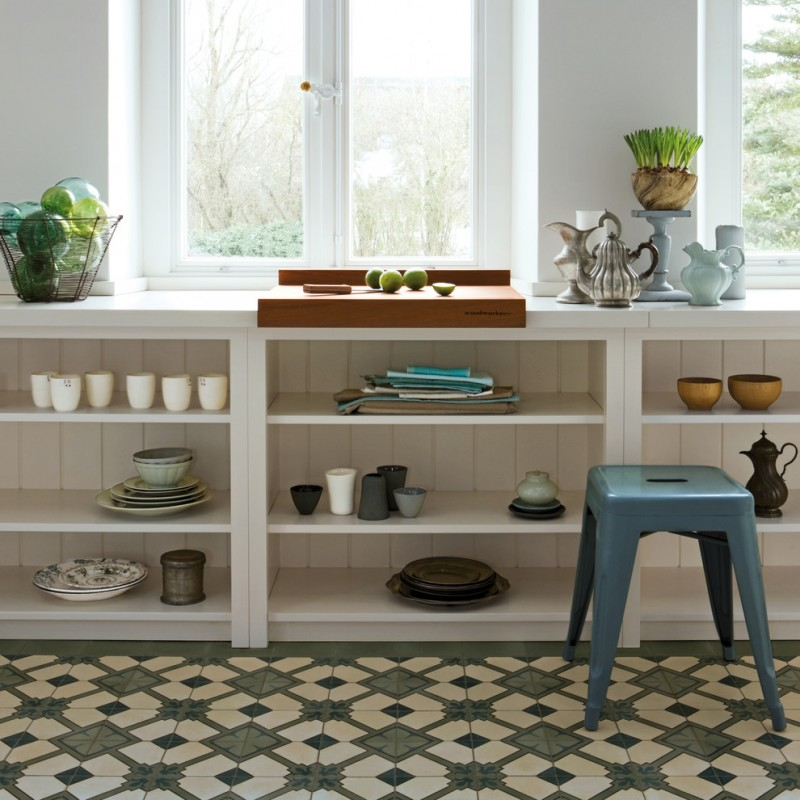 geometric patterned vintage tiles kitchen shelving idea in white white countertop wooden cutting board blue side chair