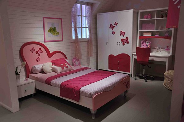girls bedroom baby pink bed frame with asymmetric heart shaped headboard in red and pink white bedside tables white wardrobe with red accents