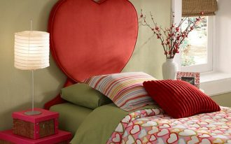 girls bedroom idea bed frame with heart shaped headboard green bed linen lots of little heart shaped comforter striped pillow red pillow pink framed bedside table