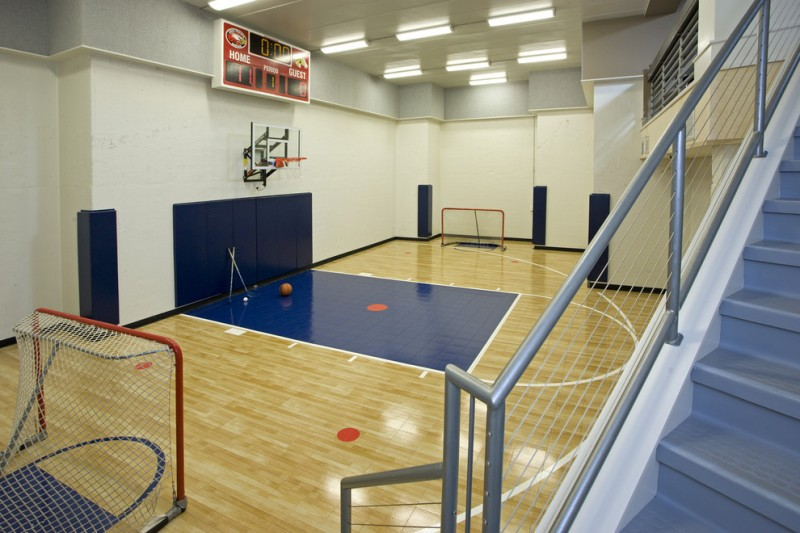 homey sport court with indoor basketball court and futsal court