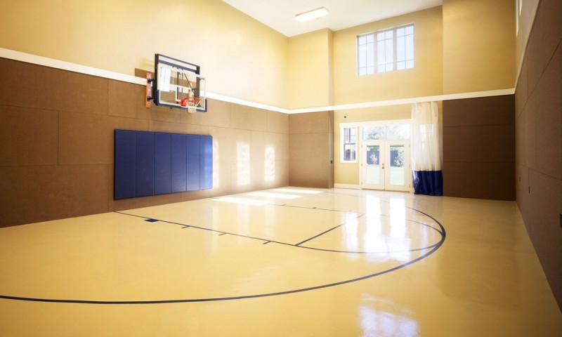 indoor basketball court for home high gloos maple court flooring dark brown painted walls cream painted walls navy blue backwall