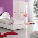 large girls bedroom purple painted wall white floors white bed frame with tufted 7 asymmetric heart shaped headboard pink bedside table with heart shaped handles