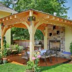 light wood gazebo metal finish outdoor chairs white covered center table string lights terracotta tiles floors brick walls