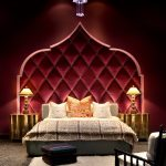 mediterranean bedroom design middle east inspired arched wall decor glowing gold bedside tables white shug rug grey carpeting idea