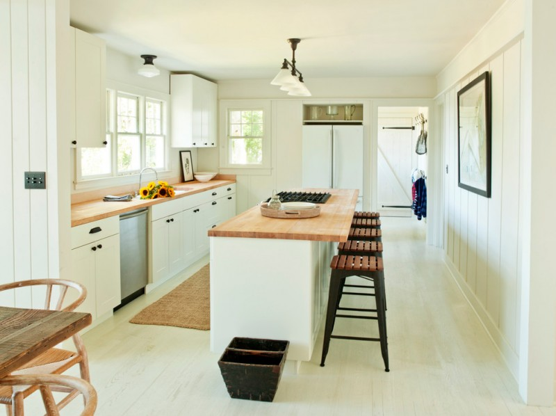 modern & clean lines kitchen idea light wood countertop and bar table darker wood bar stools white cabinets light wood colored running rug