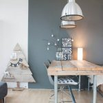 right spotted Scandinavian dining nook light wood table scandinavian style dining chairs light wood bench seat silver toned pendants
