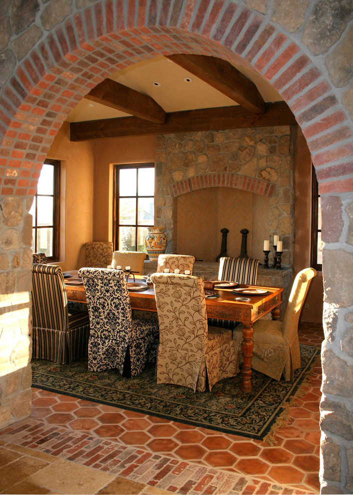 rustic mediterranean dining room dining chair slipcovers with multi pattern & color terracota tiled floors clay burnt walls fireplace with stone surrounding