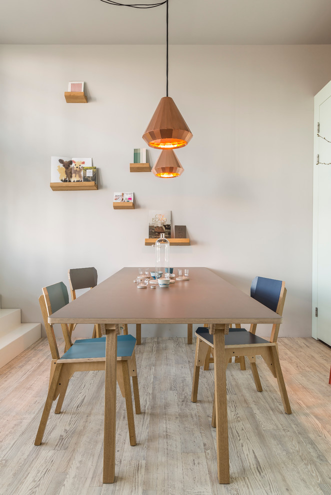 scandinavian dining room idea organic wood chairs with blue highlight organic wood dining table contemporary pendants light toned wood floors