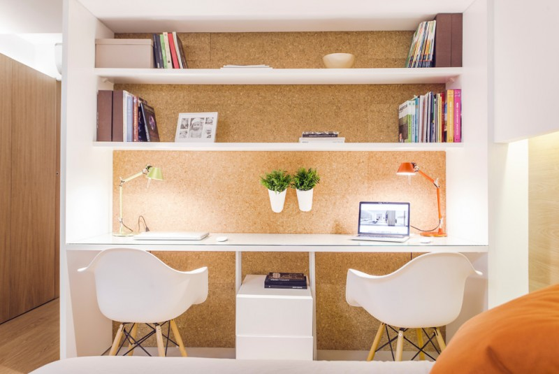scandinavian two sided working desk with cork wall panel and shelves mid century modern plastic chairs in white
