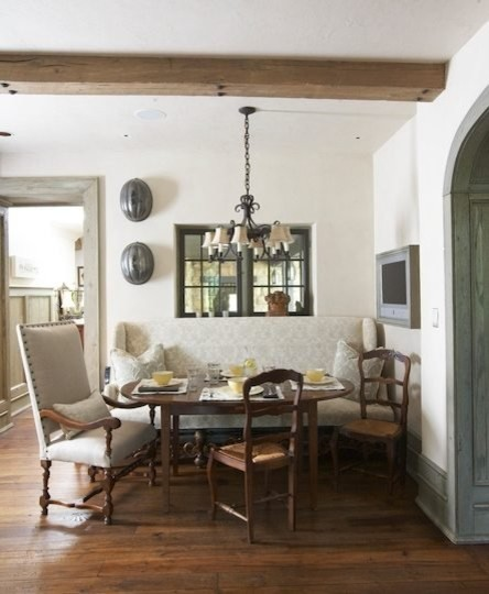shabby breakfast nook antique furnishing peices antique chandelier dark wood floors