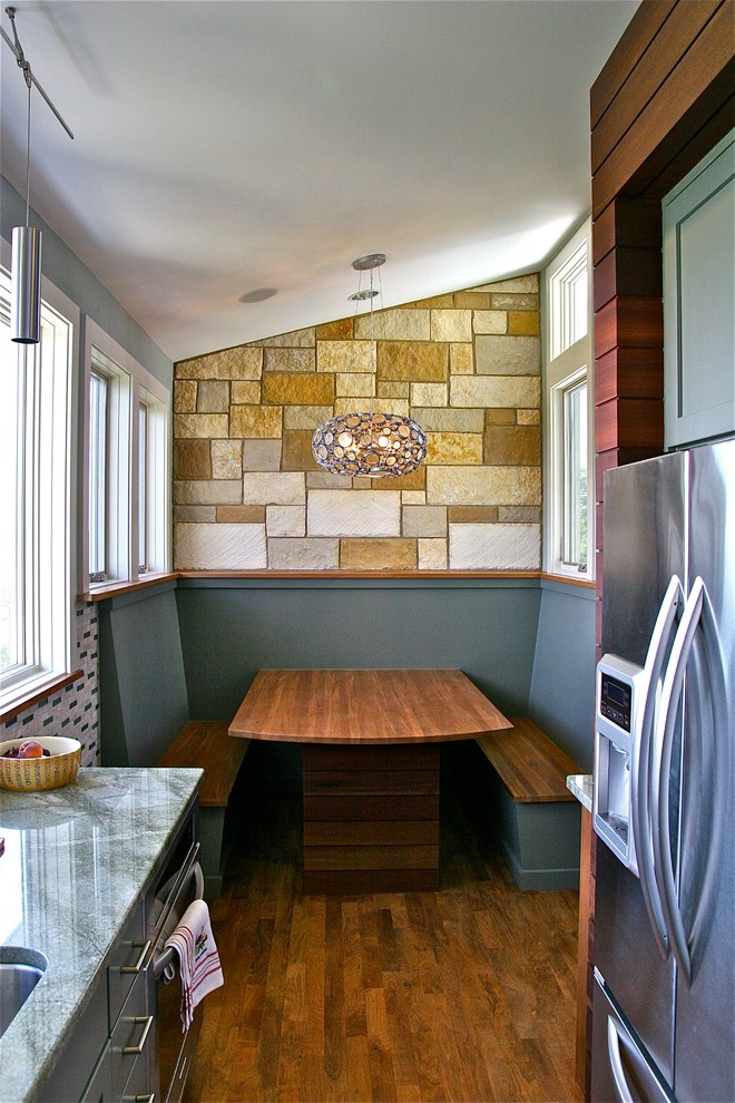 small contemporary kitchen nook white gold mosaic tiles wall blue painted wall hardwood table built in wooden bench seats unique ball pendant