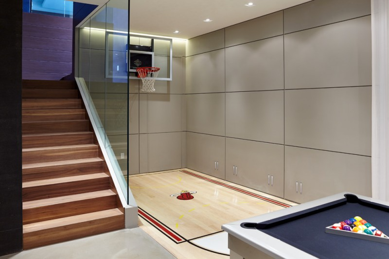 smaller modern basketball court design beside the stairs light wood floors grey wall panels