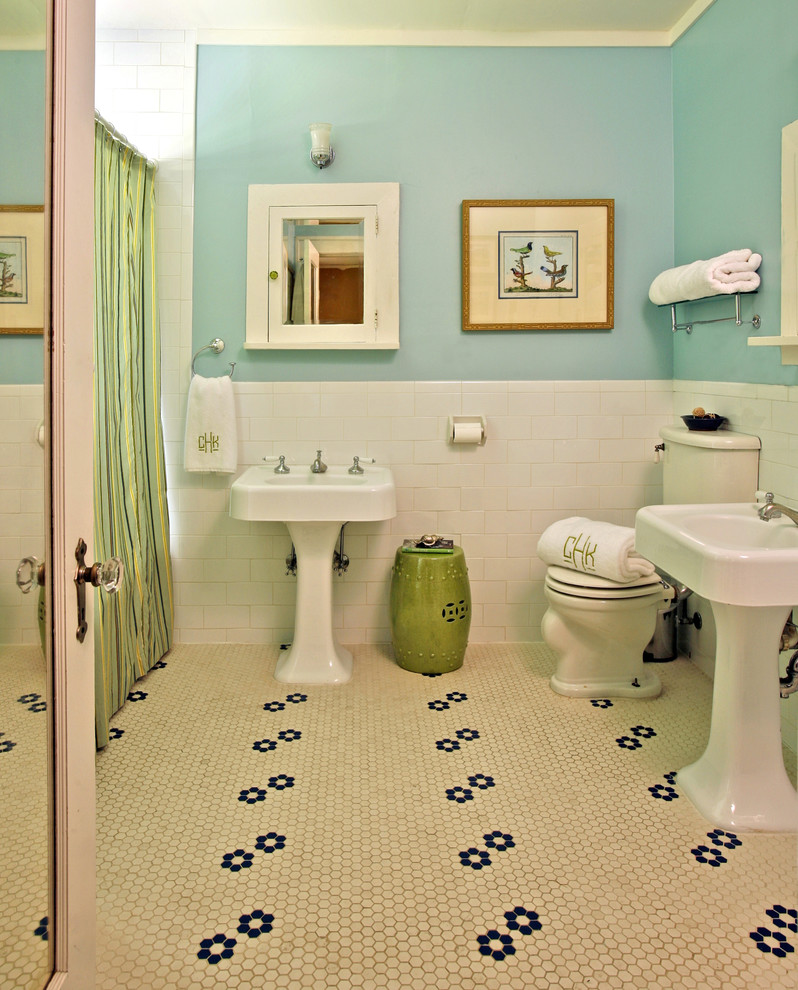 traditional bathroom pedestal sinks in white white toilet green painted side table vintage tiles with black flower patterns