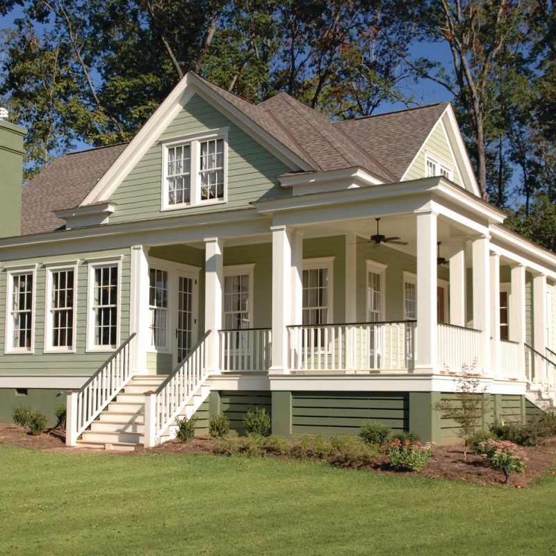 traditional exterior & porch with exterior stairs and green painted porch skirting