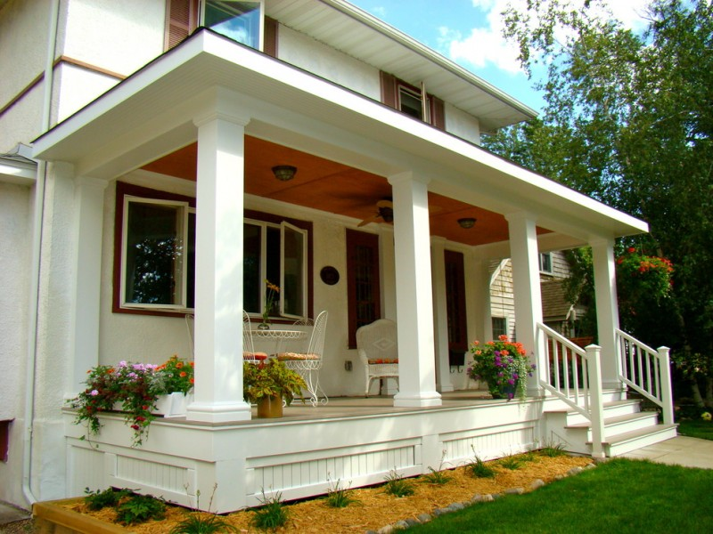 traditional front porch design white porch skirting larger white pillars white exterior wall exterior staircase with railings