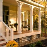 traditional front porch idea white painted lattice skirting with diamond cut ventilators medium toned wood floors white painted pillars natural stone pillars for skirting