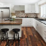transitional kitchen idea reclaimed wood countertop solid black stools reclaimed wood floors L shaped kitchen counter with granite top white kitchen cabinets