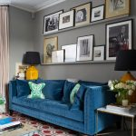 Transitional Living Room Vibrant Grey Painted Walls Deep Blue Couch Deep Blue Throw Pillows Modern Patterned Rug In Red Wall Mounted Panels For Artworks