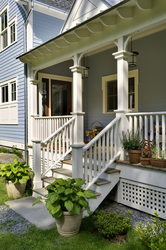white finished lattice porch skirting idea white painted railings and pillars wood floors light blue wood siding exterior walls