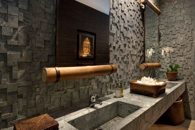 Asian style bathroom idea textured soapstone walls floating soapstone bathroom vanity with larger soapstone sinks vanity mirror with bamboo frame