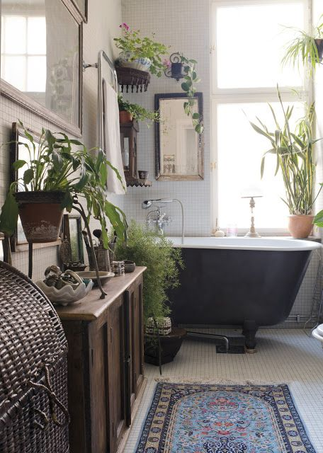 Bohemian bathroom design ethnic carpet greens black bathtub small tiled floors and walls