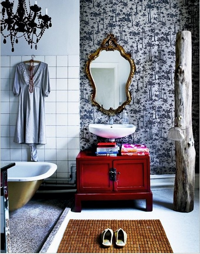 Chic Bohemian bathroom idea chic black chandelier vintage mirror with golden frame vintage cabinet in red white tiled wall floral patterned wallpaper wooden bathroom mat