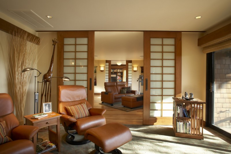 asian enclosed living room with sliding door brown leather armchairs wooden side table cube bookshelf
